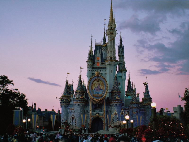 This is the Disneyworld Castle in Florida. This is a compiled photo of two pictures using HDR technology. One photo was adjusted for the proper sky exposure, one for the castle itself. A normal photo taken like this (after sunset and up into the twilight sky) will either show the sky correctly and show the castle in heavy shadow, or show the castle nicely and wash out the sky with overexposure. An HDR program takes more acceptable pixels from each photo and blends them into one image.