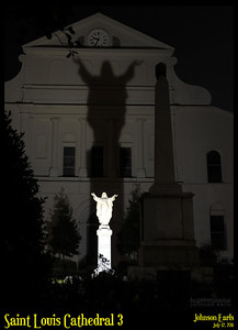 Saint Louis Cathedral 3  Saint Louis Cathedral's statue of Jesus and its shadow on the main building.  New Orleans, 12 July 2011