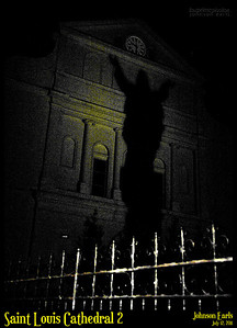 """Saint Louis Cathedral 2  The shadow of the statue of Jesus in the courtyard of the Saint Louis Cathedral.  I thought the noisy graininess of this photo gave it a """"spooky"""" feel.  New Orleans, 12 July 2011"""