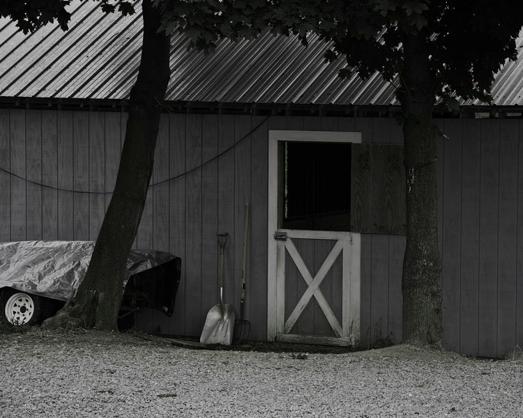 Farm shed along the road.  All it needs is Mr. Ed sticking his head out the top of the door.