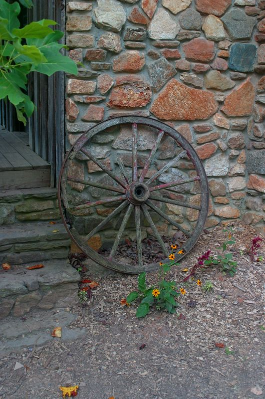 I like this combinatation of the stone and old wagon wheel, leaning against the old barn at Autrey Mill Nature Preserve.