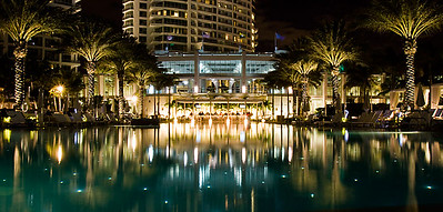 Fontainebleau pool looking into outside bar at night - Miami, florida