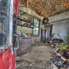 A peek inside<br /> So here we are, taking a peek inside the red door of the Depilated Gas Station.  A bit of a mess in here, it looks like what it is – a place long abandoned and forgotten.<br /> <br /> This is an HDR from 5 raw frames.  We had some problems with noise in the deep shadows.  It looks like Photomatix is picking up the noise speckles as it has higher macro contrast than the real image.  It can probably be fixed by converting the raw frames before merging.
