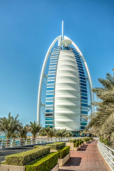 Front view of the Burj Al Arab. It is situated on a man-made island connected to the mainland Dubai by a private bridge.