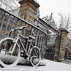 Judge Business School and student bike are covered by snowfall