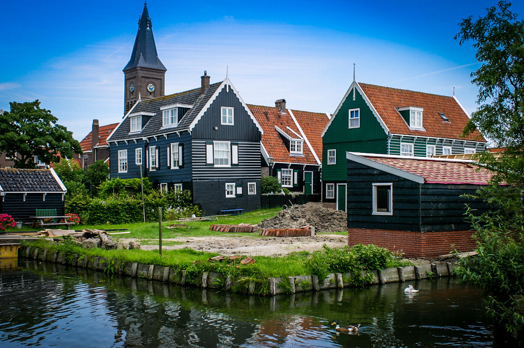 Marken, Netherlands<br /> Traditional wooden houses, with the Gereformeerde Church in the background.