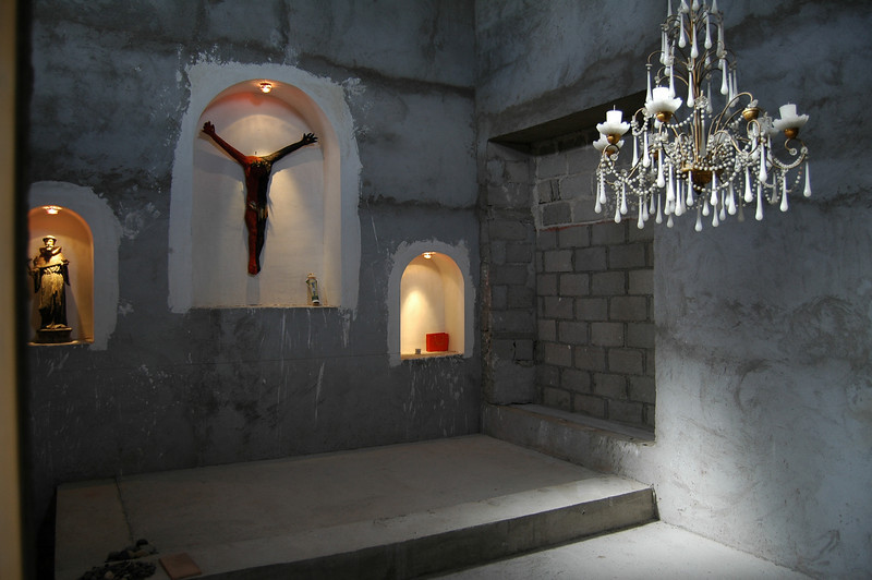 I am not into any religion - I copied a chapel I saw in a Mexican Hacienda. Because I liked the feel of it. Its my meditation room with conventional (unconventional?) appearance