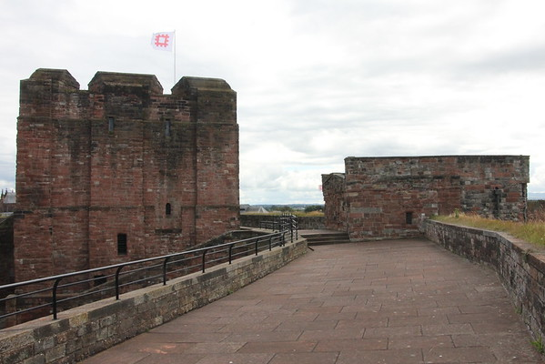 Looking along the wall towards the Captain's Tower and Keep.<br /> Carlisle Castle<br /> 25 July 2015