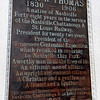 memorial plaque on east side of the John W. Thomas statue base