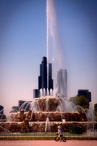 Little tyke staring in amazement at Buckingham Fountain