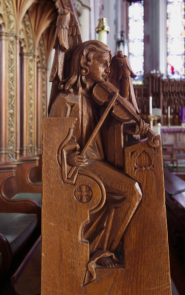 Choir Pew Figure 1: Angel with a Viol, front