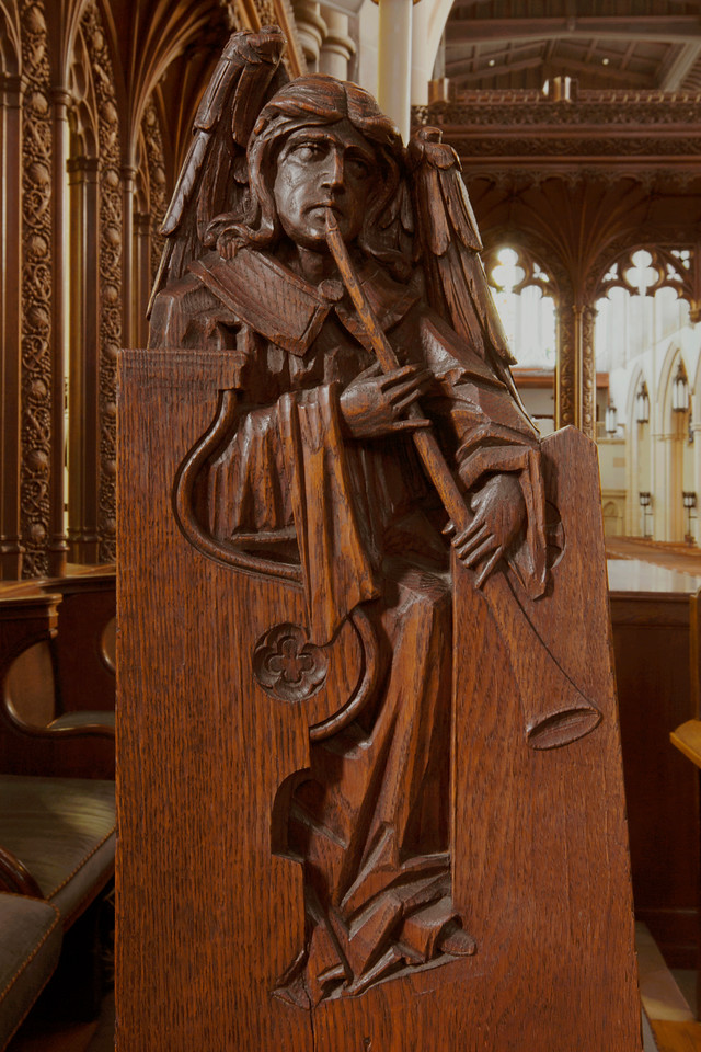 Choir Pew Figure 7: St. Angel with Heraldic Trumpet, front