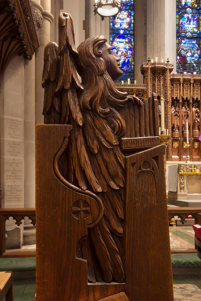 Choir Pew Figure 12: Angel Holding a Portatif, rear