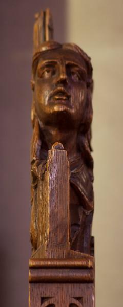 Choir Pew Figure 12: Angel Holding a Portatif, profile