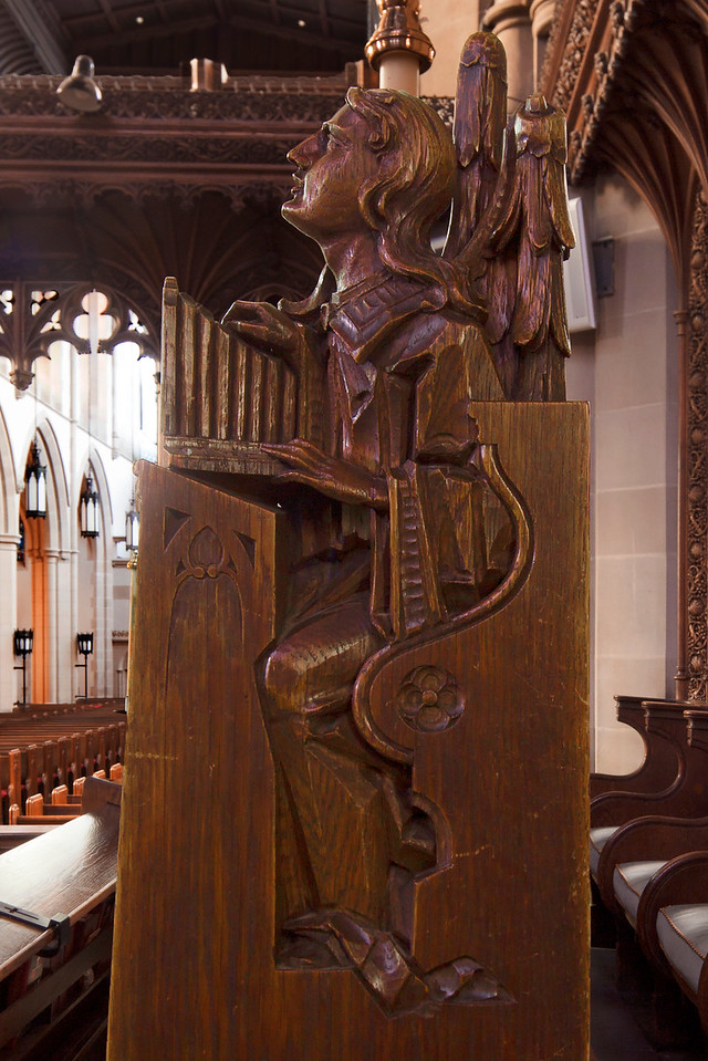 Choir Pew Figure 12: Angel Holding a Portatif, front