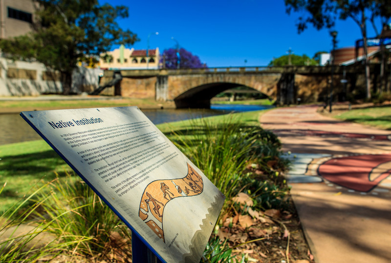 Parramatta, NSW, Australia<br /> The mural tells the story of the school known as the 'Native Institution' (1814-1822), an early attempt to force Aboriginal children to conform to a British way of life. The bridge in the background is the Lennox Bridge, built 1836-1839.