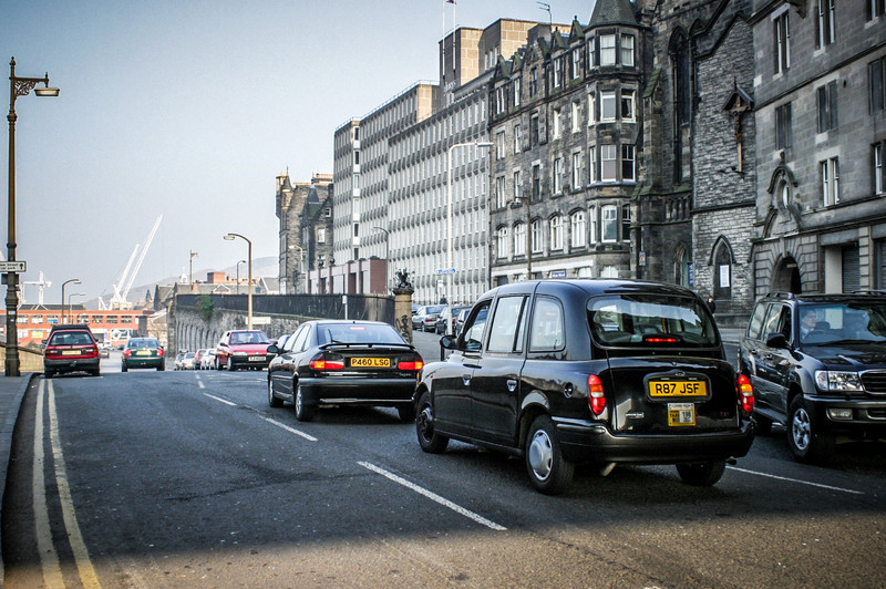 Edinburgh, Scotland<br /> Heading along East Market St, with Jeffrey St on the right. Visible are Old St Pauls, the Jurys Inn hotel, and the former Eastern Scottish Bus Depot (the red building at the end), demolished in 2006.