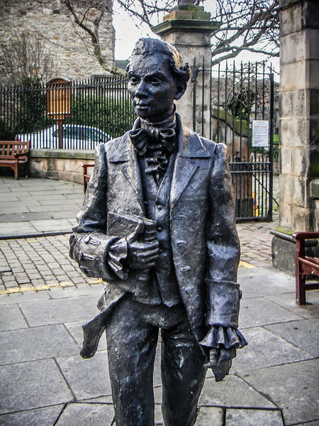 Statue of the poet Robert Fergusson, who was born nearby and is buried in the Canongate Kirkyard.