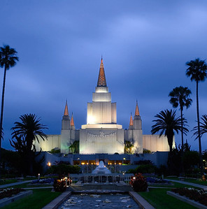 LDS Oakland Temple in California at dusk, fully lit. Windy