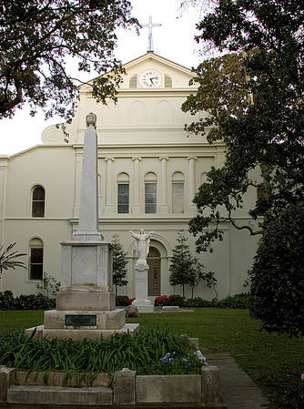 Historical St. Louis Cathedral on Jackson Square, in New Orleans, Louisiana, rear view with trees