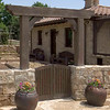 Intimate Spanish Courtyard leads into a chicken coup and grain storage.