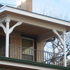 A restored balcony over a new addtion on the back of this Congress Park Denver Square, sensitively updates its historic character.