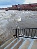 Rising River<br /> The Merrimack was high and rushing today.  More mill buildings turned offices, manufacturing and warehouses on the other side.    Pilings are all that remain of an old bridge.  <br /> Jan 2010