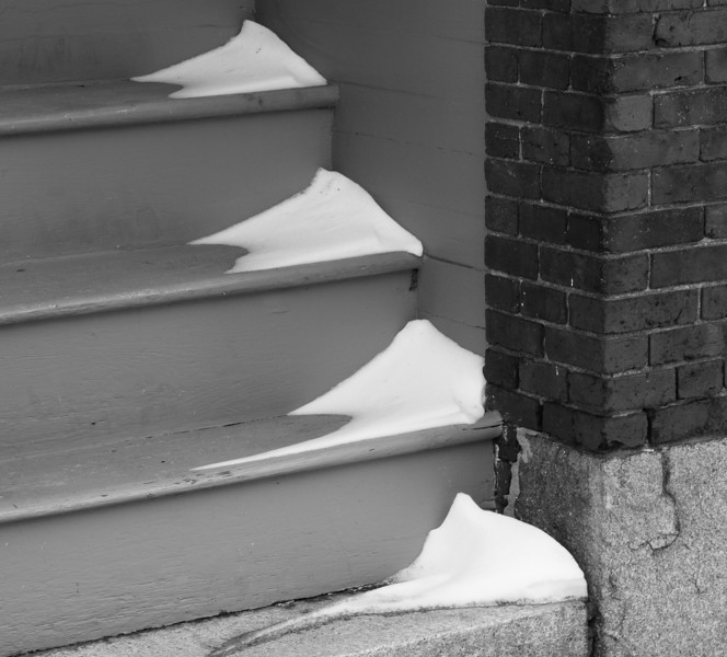 Snow gathers in tiny drifts on a staircase in Manchester, NH