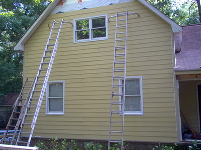 Day 6 - Siding and windows trimmed