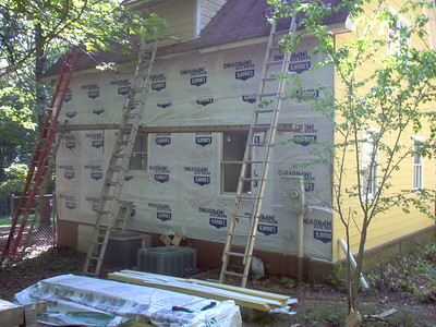 Day 8 - East Endwall - Siding and electrical removed, housewrap, windows rebuilt.