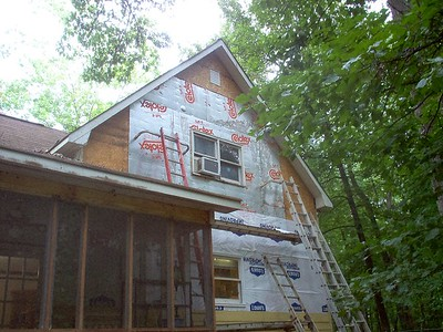 Day 10 - Siding removed from rear of house and replacement begun