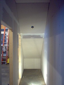Sheetrock is added to the closet interior.