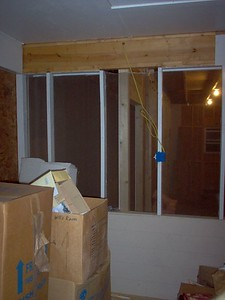 A shot from inside the screened porch showing the intersection of the division wall. This wall will be continued across the interior of the porch and terminate against the house.