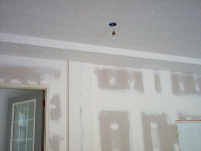 Tray in the ceiling contains bonus room plumbing.