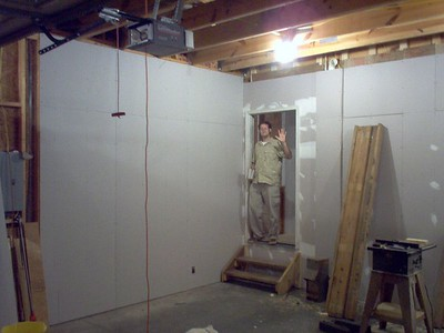 More sheetrock. #1 son waves from new back door.