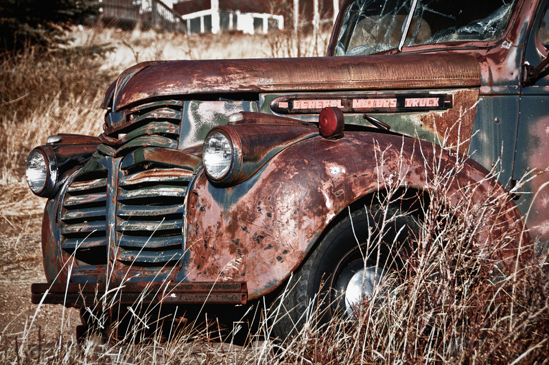 A General Motors truck from years ago sitting in a field in the gold mining town of Victor, Colorado.