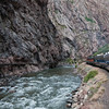 Running through the Royal Gorge Canyon with the onetime Canon City water supply pipe on the left side of the canyon.