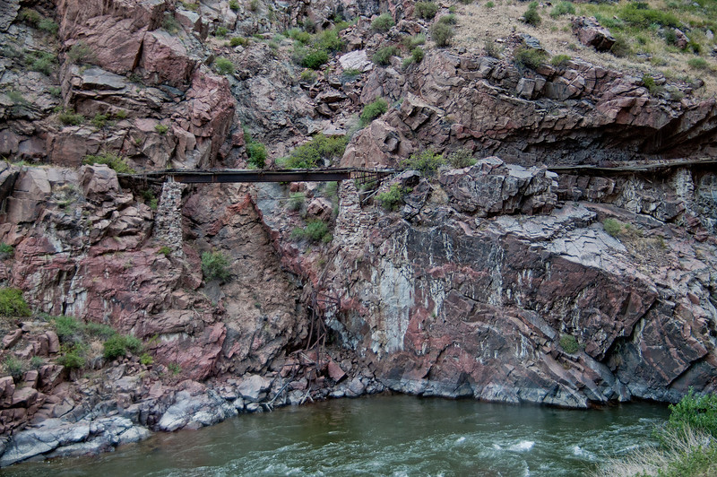 Remains of the handmade, wooden, water supply pipe running along the Arkansas River that once fed the town of Canon City, Colorado.