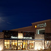 A full moon rising behind haze over Arhaus and Macy's, Park Meadows Mall.