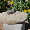 ... a day after putting the rock in place, I noticed it was one of the ancient Indian grinding stones, a metate. I have collected already hundreds of pounds of manos, the stone the Indians ground with, so I put a nice one atop. Just found two more arrowheads today and placed them there as well.