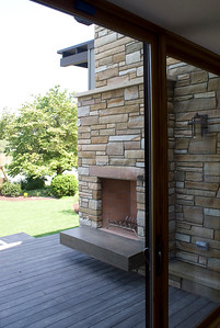 Rear view: stone chimney fireplace from interior