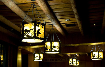 Entrance promenade: ceiling lamps with animal decorations