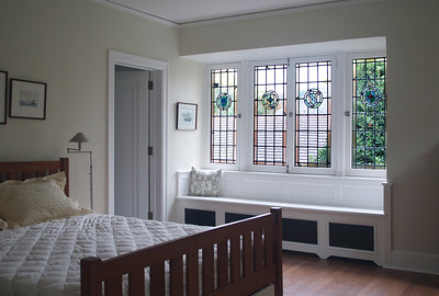 Bedroom: bed and stained glass windows