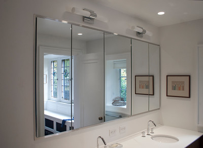 Bathroom: sink and mirror-view of room