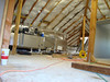 "this is the attic, a part of it, with the new heater/AC being installed - don't forget, the old attic was 3"" high - big improvement"