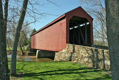 Loy's Station Covered Bridge  First constructed circa 1848, the Loy's Station Covered bridge is on Old Frederick Road, just south of Rt. 77. Although it has been structurally modified and rebuilt, the bridge's original timbers remain throughout the 90-foot long structure crossing Owens Creek, features a multiple Kingpost design. An adjoining park provides picnic tables and a play area.  Old Frederick Road, South of Rt. 77 Thurmont, MD 21788   PHOTO BY: J. COCHRAN