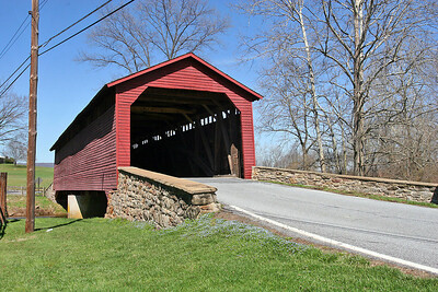 Utica Mills Covered Bridge  The Utica Mills Covered Bridge, circa 1850, is located on Utica Road off of Old Frederick Road. The bridge originally spanned the nearby Monocacy River but was washed away during a severe storm in 1889. Local citizens gathered the remains and reconstructed the 101-foot long Burr Arch design bridge at its present location crossing Fishing Creek.  Off Old Frederick Road, near Utica  Utica, MD   PHOTO BY: J. COCHRAN