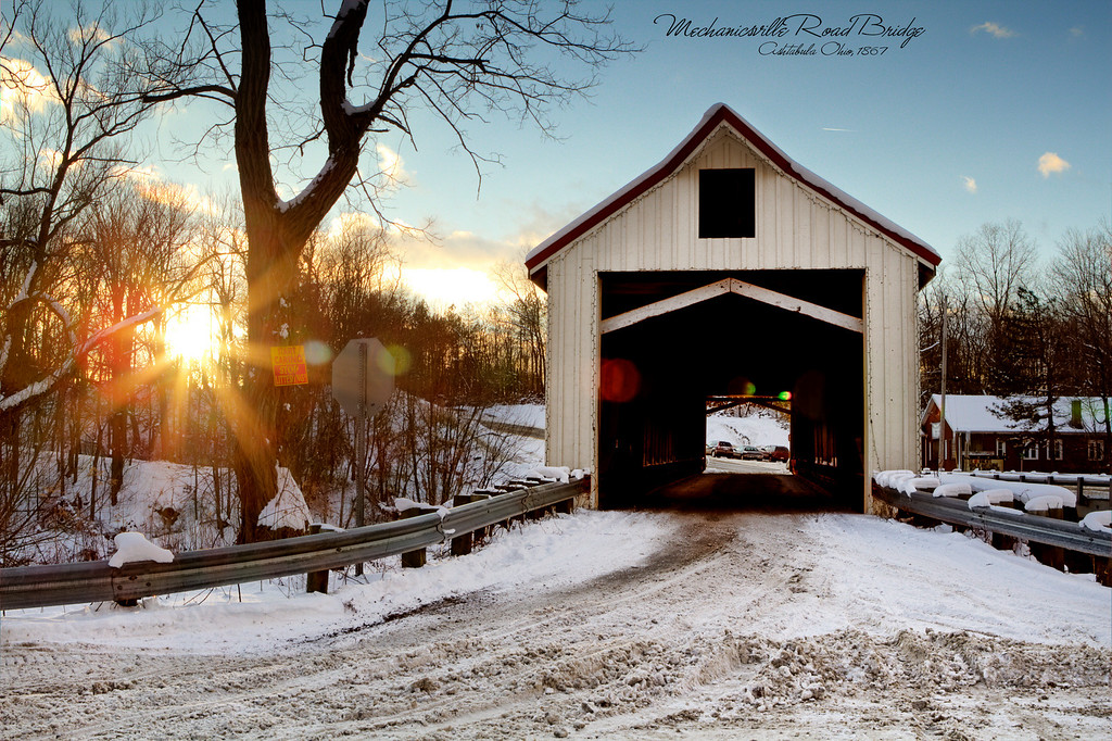 Mechanicsville Road Bridge <br /> The second longest single-span Covered Bridge in Ashtabula County, this 156 ft. Howe truss with arch was built over Grand River in 1867. The arch is 15 layers of 2 x 8 lumber encased by large beams which form the X's of the Howe truss. Believed to be the oldest of the County's covered bridges. This bridge was renovated in 2003-2004 and was once again opened to traffic in the spring of 2004