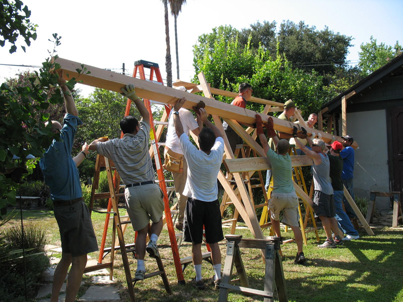 Passing the beam upwards, everyone lifts