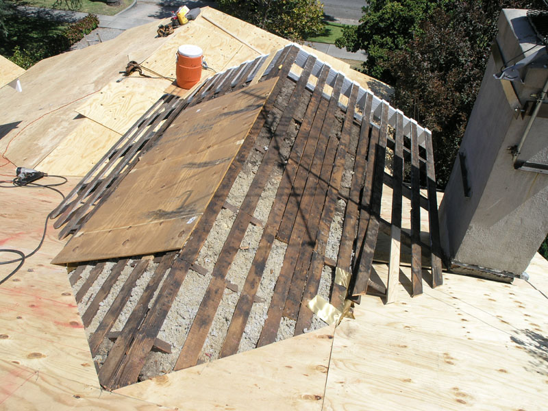 Before plywood was placed, 4x6 wood blocks and extra 1x4 sheathing was added onto the front dormer roof next to the chimney for attaching chimney braces later.